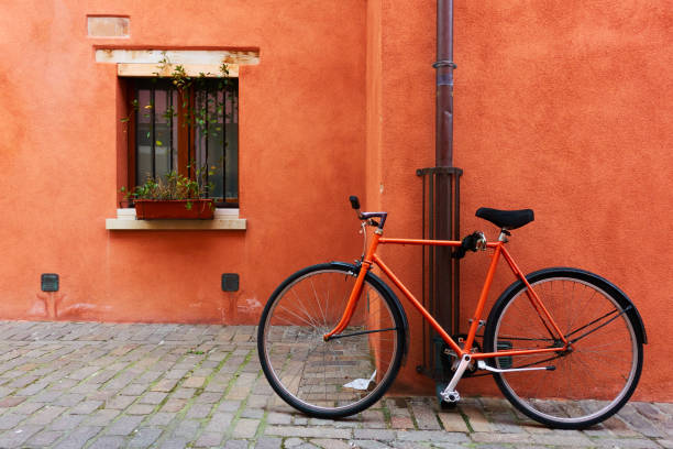 Red bicycle near old house in Rimini stock photo