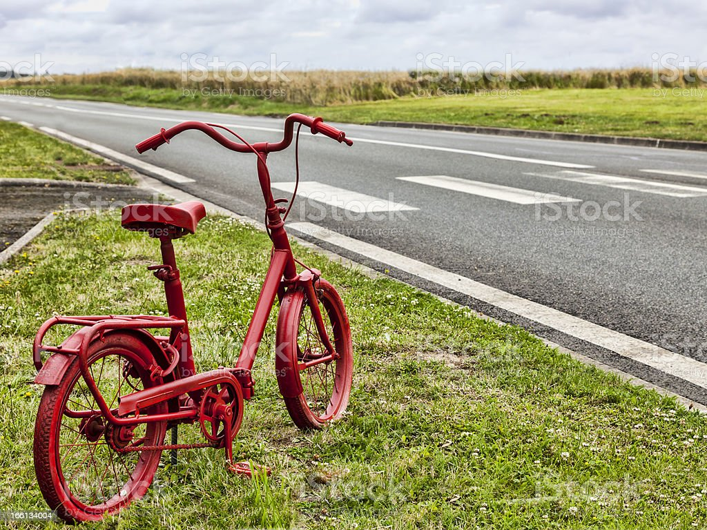 Red Bicycle on the Roadside royalty-free stock photo
