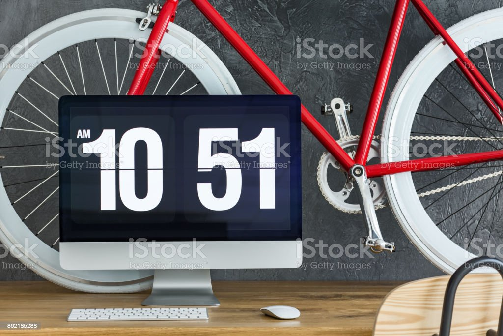 Red bicycle on wooden desk stock photo