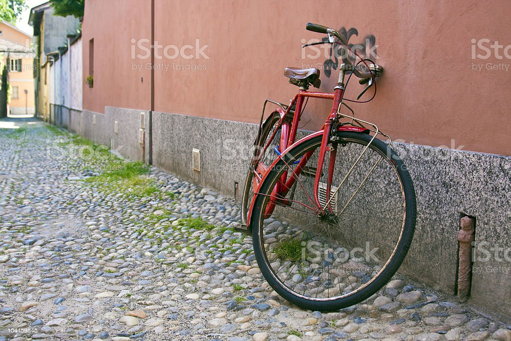 Red bicycle standing against a wall royalty-free stock photo