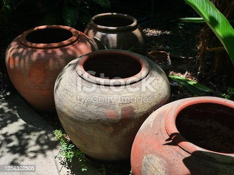 Red Large jar made at home for rainwater storage in thailand