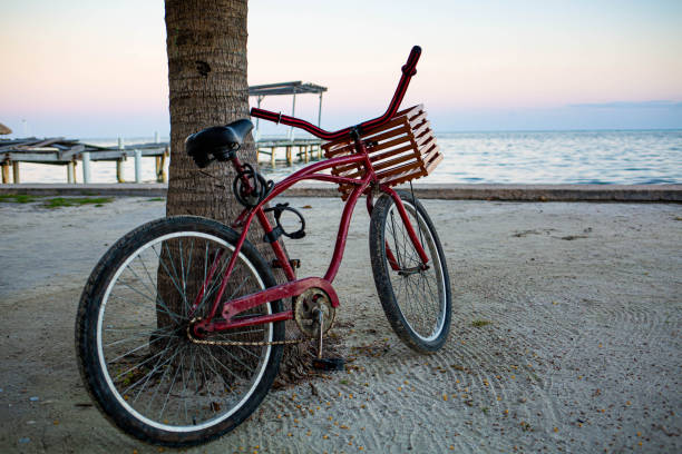 Red bike at the seashore with nobody ready to ride stock photo