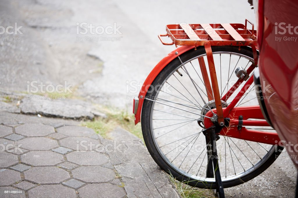 Red bike, close-up. Street in Thailand stock photo