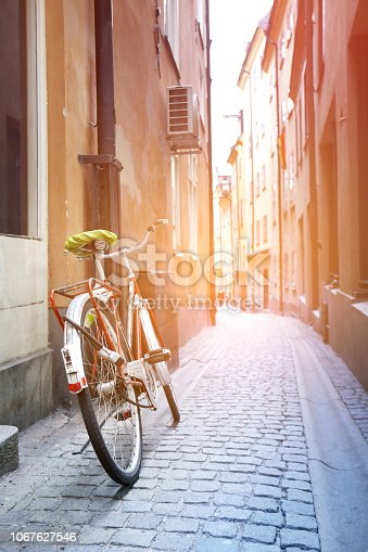 Bike on the old narrow street. Morning sunshine