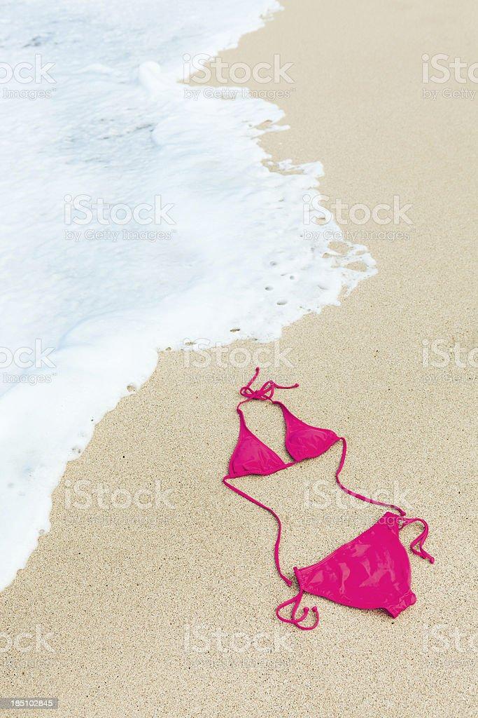 Red Bikini on Tropical Paradise Vacation Beach Sand, Kauai, Hawaii royalty-free stock photo