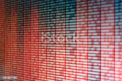 istock Red Binary Code. line of computer languages. 1001827762