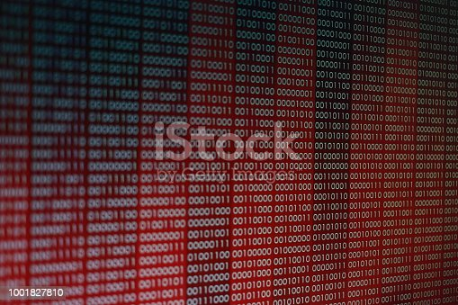 istock Red Binary Code. line of computer languages. 1001827810