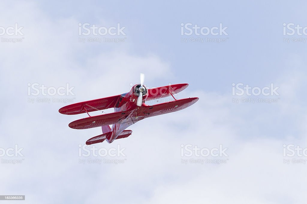 Red Biplane Flying stock photo
