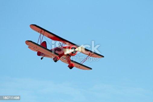Remote control model bi-plane in flight.