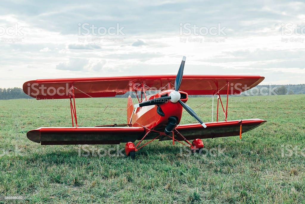 Red biplane stock photo