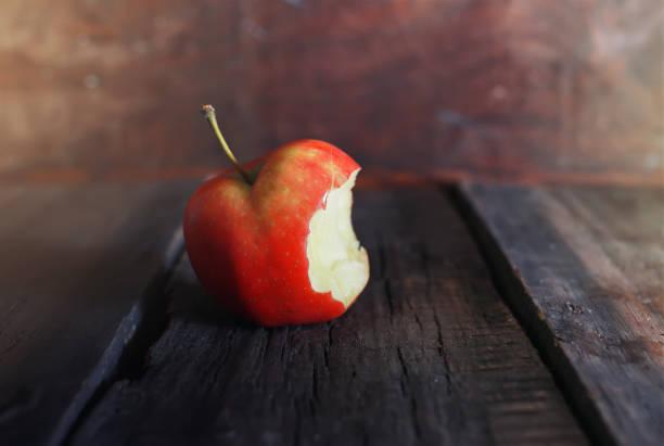 red bitten apple stock photo