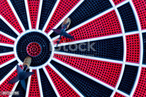 istock red, black and white dartboard 507242785