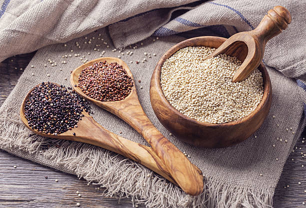 red, black and white quinoa seeds - quinoa stock photos and pictures