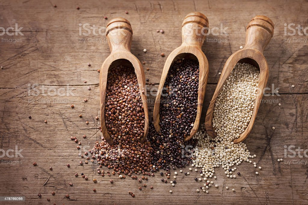Red, black and white quinoa seeds stock photo