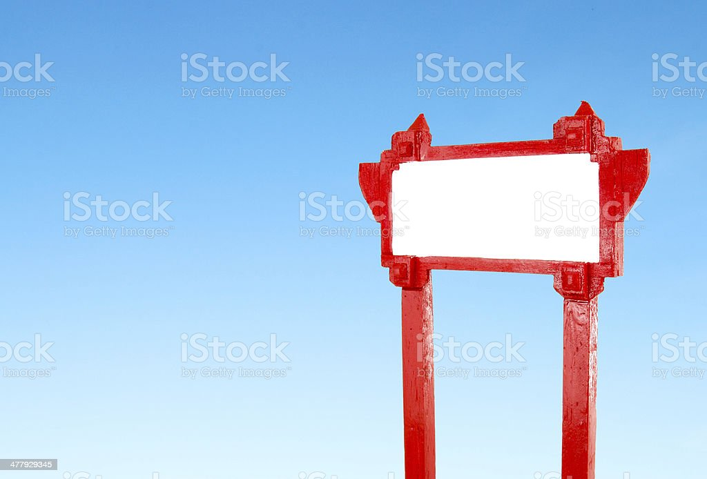 red blank wooden sign with blue sky royalty-free stock photo