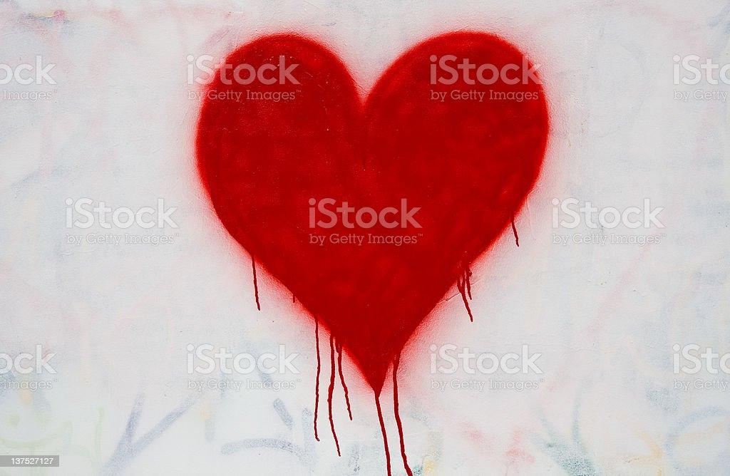 red bleeding heart spray painted stock photo