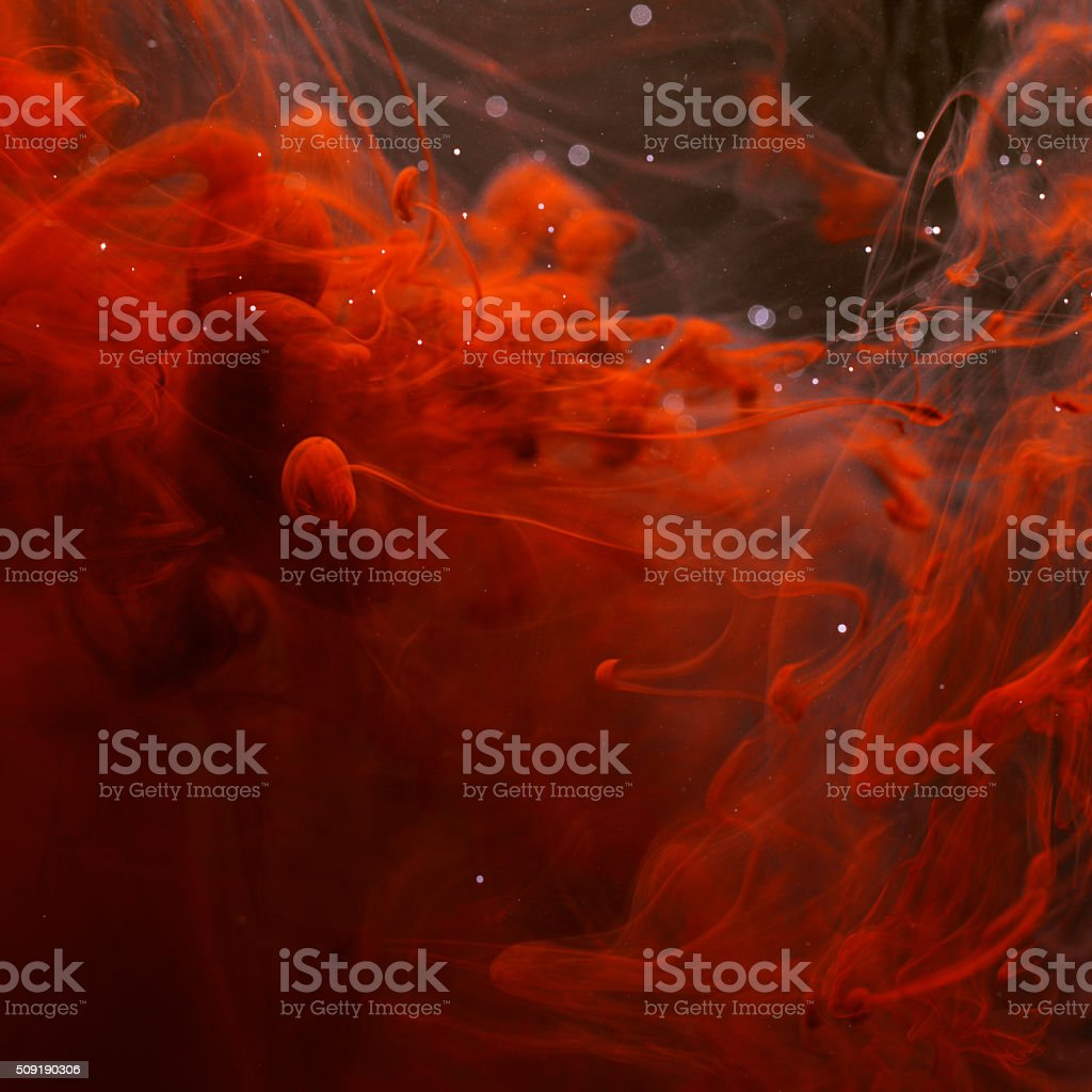 Red blood ink in water stock photo