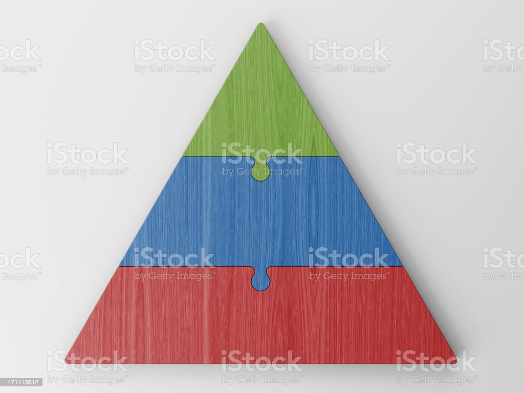 A red, blue, and green pyramidal puzzle hierarchy stock photo