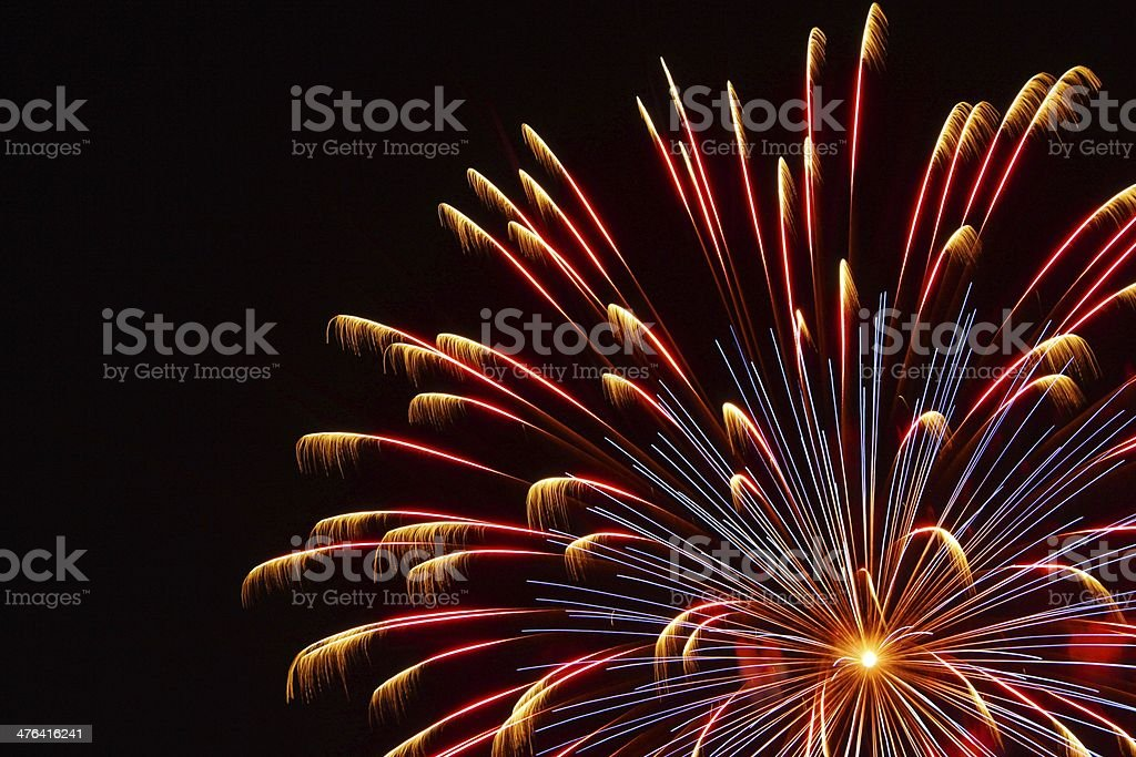 Red Blue and Yellow Fireworks royalty-free stock photo
