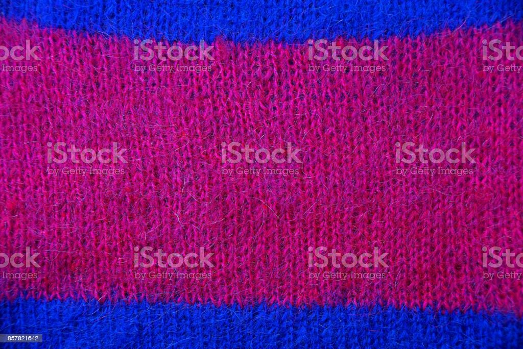 Red blue fabric texture of a piece of sweater stock photo