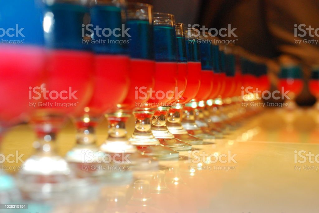 A tray of colorful shots. Red and Blue Shooters are more on the tamer...