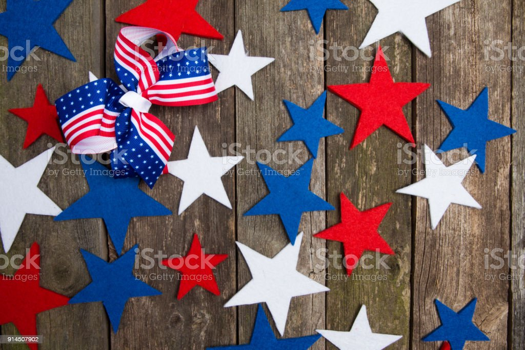 Red blue, white stars and bow with American flag on wooden...