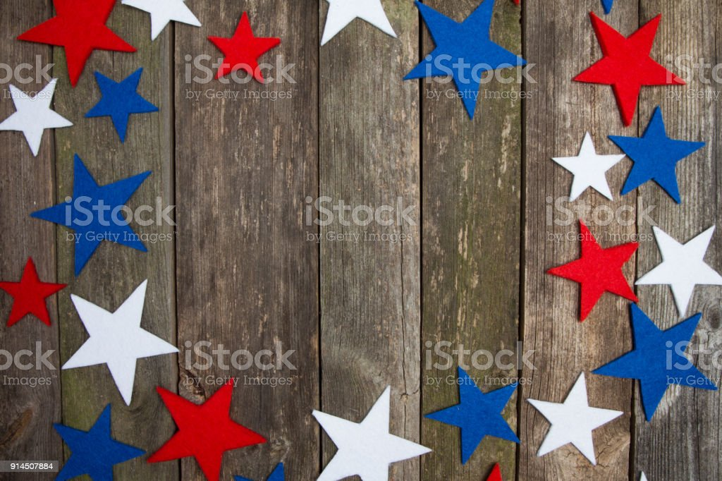 Red blue, white stars on wooden old rustic background. Independence...
