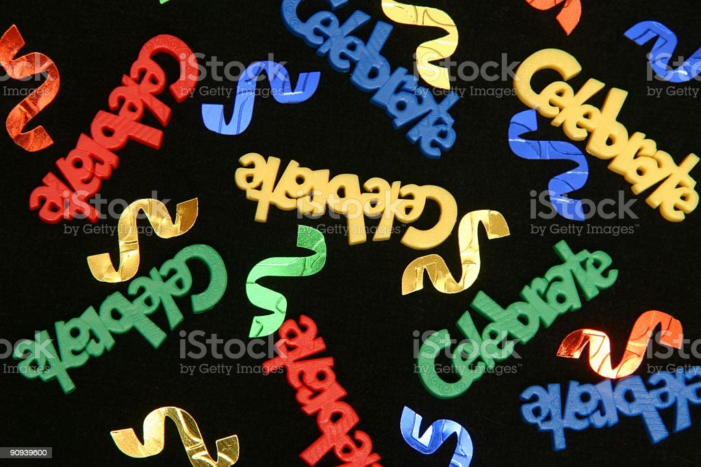 Red, blue, yellow, green Celebrate Confetti on black background royalty-free stock photo