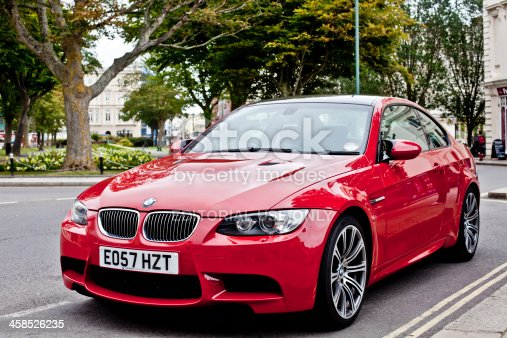 Brighton, United Kingdom - July 7, 2011: A Red Bmw type M3 parked on the street. Bayerische Motoren Werke AG (BMW), (literally English: Bavarian Motor Works) is a German automobile, motorcycle and engine manufacturing company founded in 1916