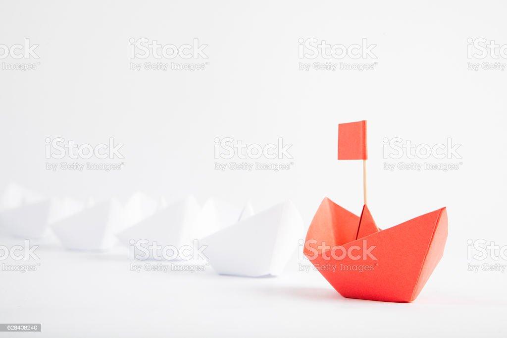 Red Boat Leadership Concept on White Background - foto de acervo