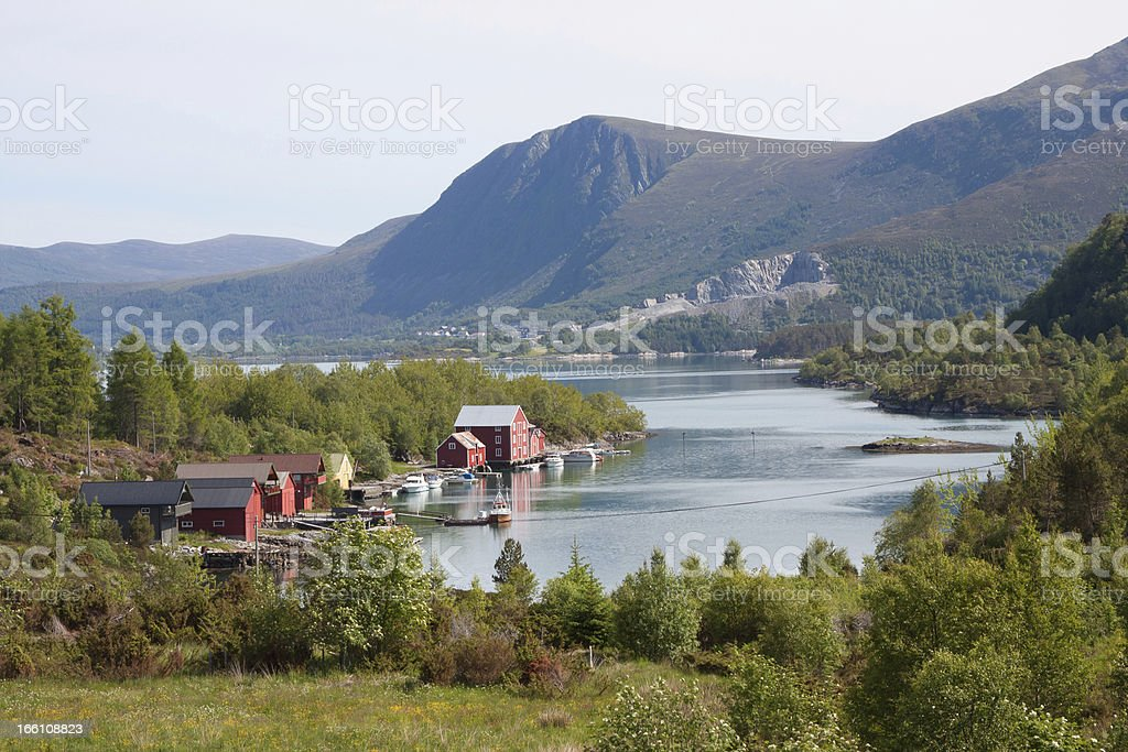 Red boathouses along a fjord in Norway (More og Romsdal) stock photo