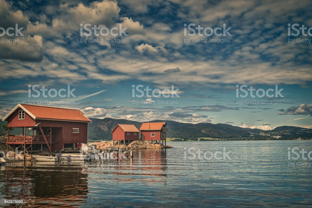 Red boathouses in Norway stock photo