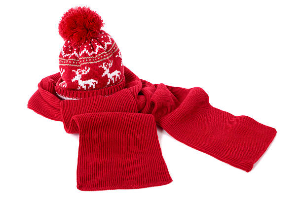 Red bobble hat and scarf Red bobble hat and matching scarf isolated against a white background.  Alternative version with blue scarf and matching hat: headscarf stock pictures, royalty-free photos & images
