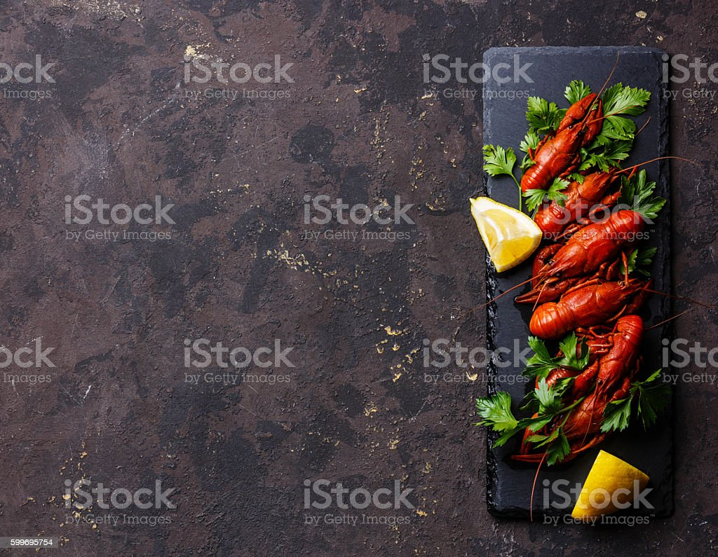 Red boiled crayfish with lemon stock photo