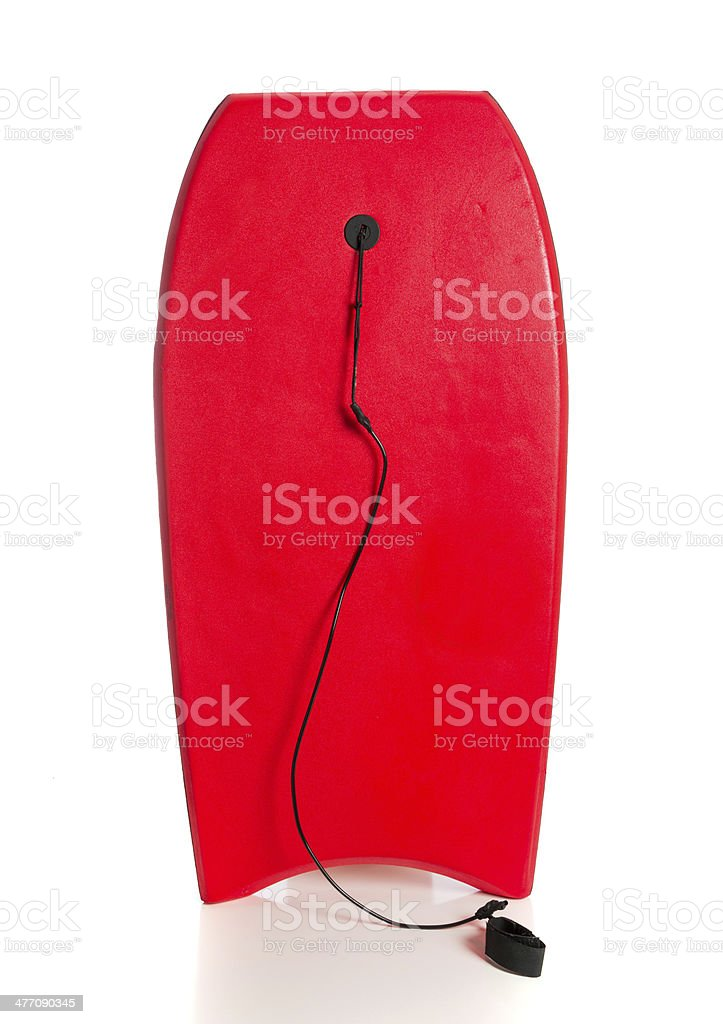 Red boogie board on a white background stock photo
