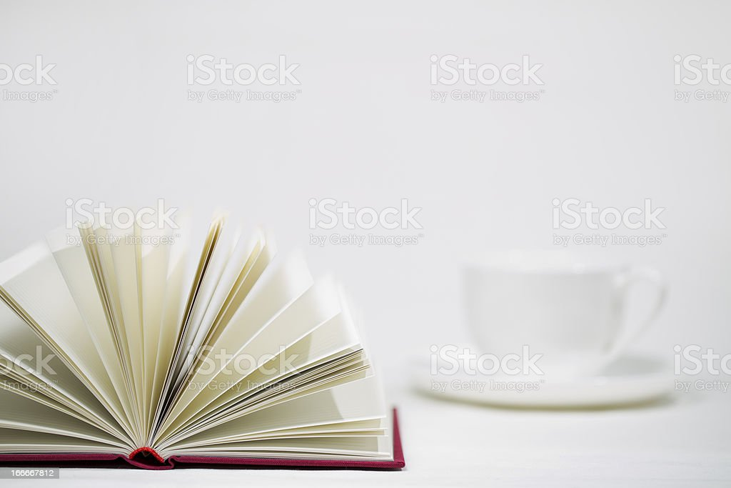 Red book and cup royalty-free stock photo