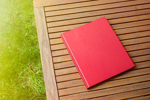 Red book on the outdoor table at coffee shop