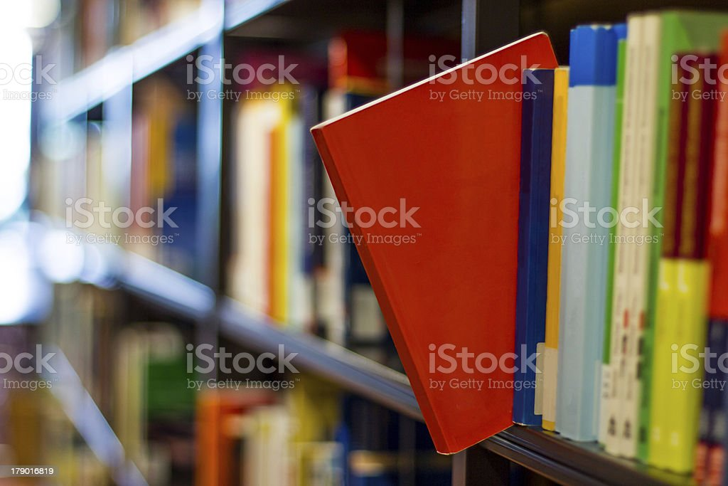 red book popping out a bookshelf royalty-free stock photo