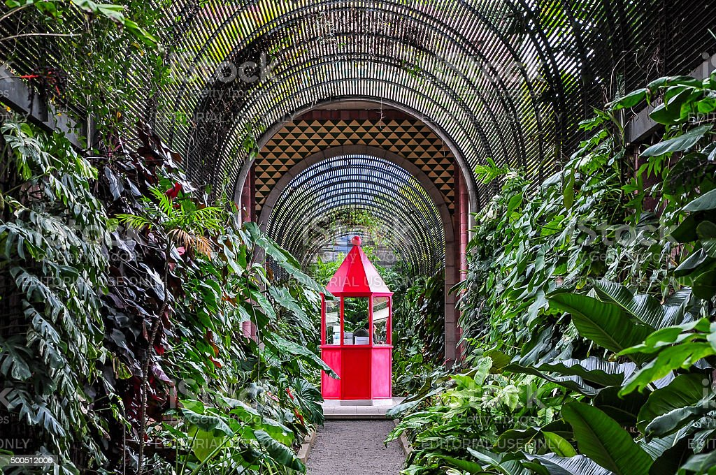 Red booth in botanical garden stock photo