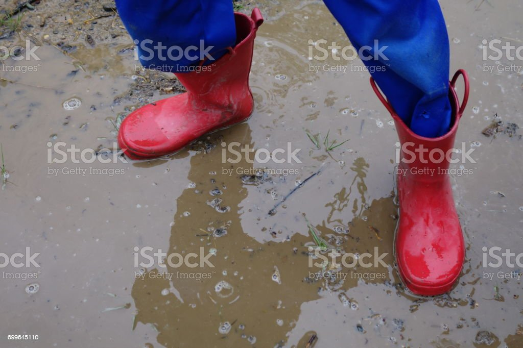 Red Boots in Rain Puddle stock photo