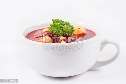 istock Red borscht with dumplings decorated with parsley 1075139124