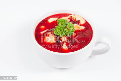 istock Red borscht with dumplings decorated with parsley 1075139170