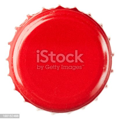 Macro image of a red, metal bottle top.