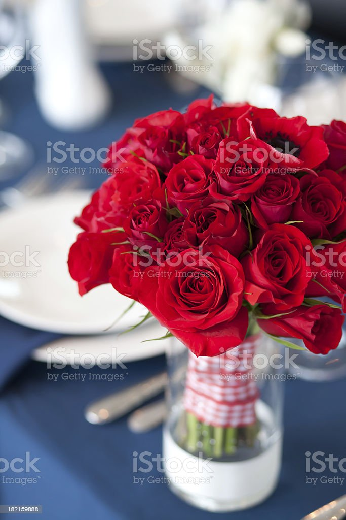 Red bouquet in vase on table royalty-free stock photo