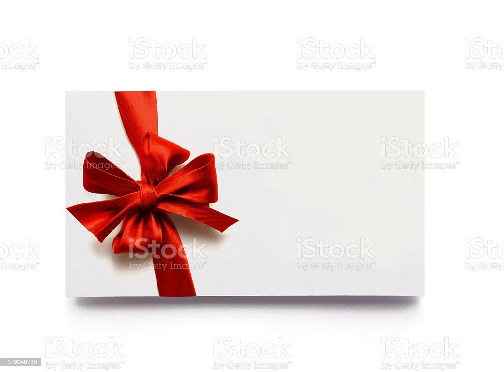 Red bow and ribbon on a white gift box stock photo