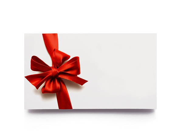 red bow and ribbon on a white gift box - gift tag note stock photos and pictures
