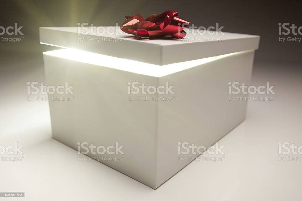 Red Bow Gift Box Lid Showing Very Bright Contents royalty-free stock photo