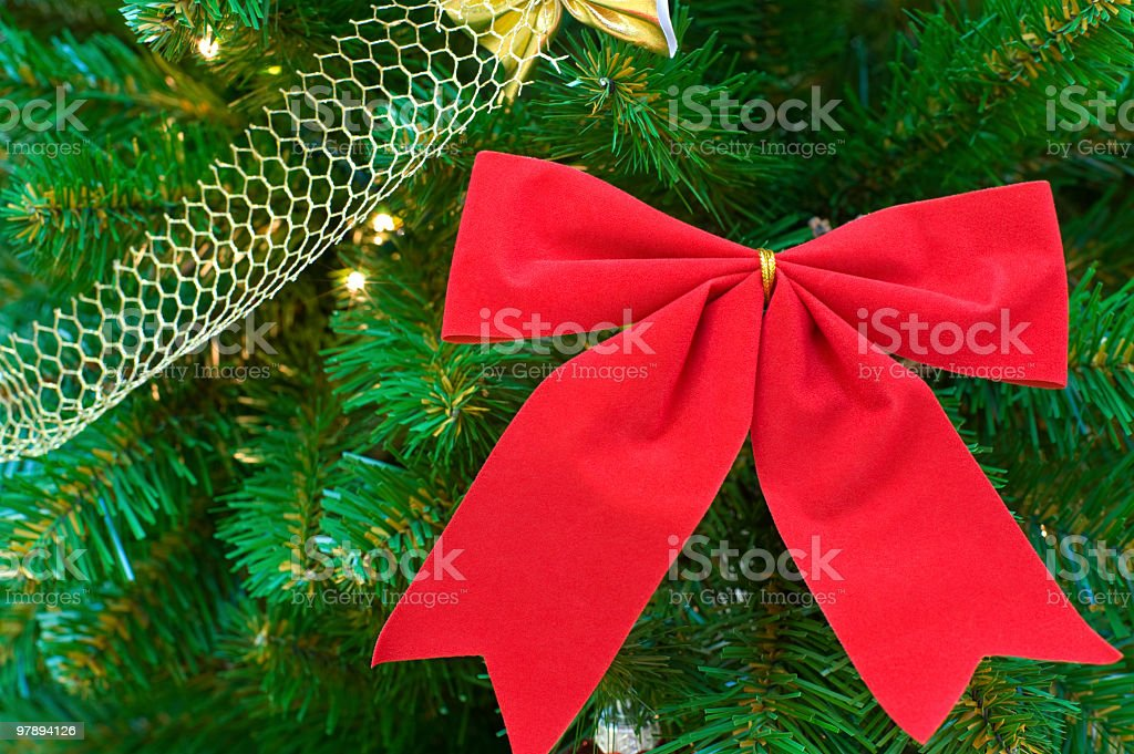 red bow on christmas tree royalty-free stock photo