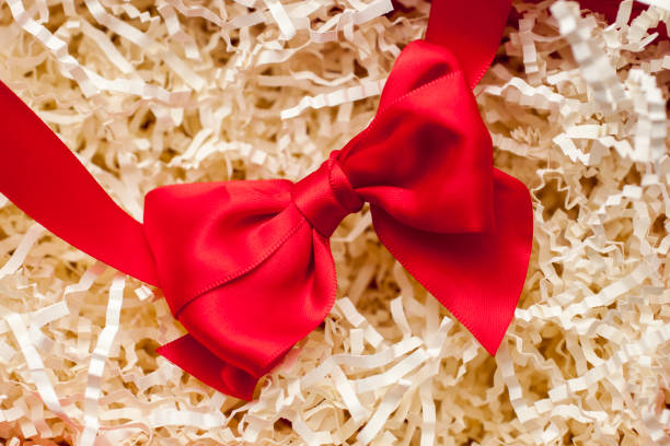 Red bow on paper filling. stock photo