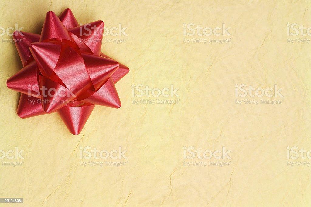 Rote Schleife auf strukturierten Papier Hintergrund Lizenzfreies stock-foto